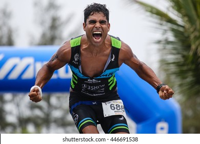 RIO DE JANEIRO, BRAZIL - OCTOBER 4, 2015: Athlete celebrates after crossing the finish line of Ironman 70.3 Rio de Janeiro