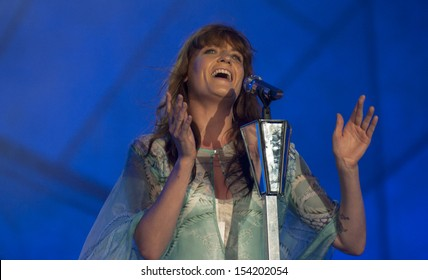RIO DE JANEIRO, BRAZIL - SEPTEMBER 14: British singer Florence performs during the  Rock in Rio 2013 concert on September 14, 2013 in Rio de Janeiro, Brazil.