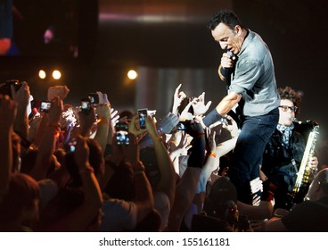 RIO DE JANEIRO, BRAZIL - SEPTEMBER  21:  US singer Bruce Springsteen performs among the audience during the Rock in Rio 2013 concert ,  on September 21, 2013, in Rio de Janeiro, Brazil.