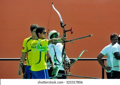 RIO DE JANEIRO, BRAZIL: SEPTEMBER 20, 2015:  Archer Bernardo Oliveira of Brazil ready to shoot arrow at competition against India as part of Archery challenge of AqueceRio test event for 2016 Olympics