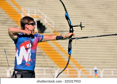 RIO DE JANEIRO, BRAZIL: SEPTEMBER 20, 2015:  Archer aiming during practice as part of the Archery challenge at AqueceRio test event for the 2016 Olympics.