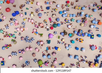 Rio de Janeiro, Brazil, top view of Copacabana Beach showing colourful umbrellas and people relaxing on a summer day. Tropical travel and vacation concept.