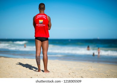 RIO DE JANEIRO - CIRCA FEBRUARY, 2018: A Brazilian lifeguard looks out at swimmers in the waves on Ipanema Beach.