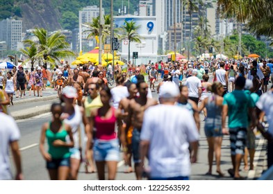 RIO DE JANEIRO - CIRCA FEBRUARY, 2018: Crowds of residents take to the Ipanema beachfront on a car-free weekend for exercise and recreation.