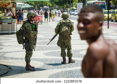 RIO DE JANEIRO - CIRCA FEBRUARY, 2018: Armed soldiers in full uniform stand guard on Copacabana Beach, filling a security void left by a police strike over unpaid wages after corruption scandals.