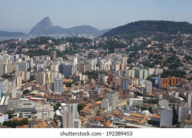 RIO DE JANEIRO, DECEMBER 28, 2013 - Aerial city view with sugarloaf mountain on the background