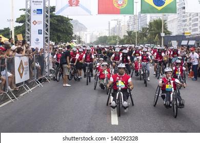 RIO DE JANEIRO - FEB 17: Start of the Cyclistic Ride WBT in Copacabana Beach with.deficients in front. Event World Bike Tour Rio de Janeiro on February 17, 2013 in Rio de Janeiro, Brazil.