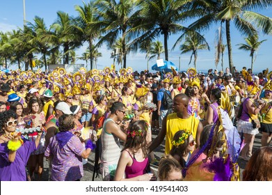 RIO DE JANEIRO - FEBRUARY 07, 2015: Brazilians celebrate at the Simpatia e Quase Amor carnival street party on a sunny summer afternoon along Ipanema Beach.