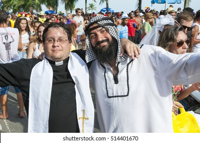RIO DE JANEIRO - FEBRUARY 07, 2015: Brazilians celebrate carnival in religious costumes, one Christian, one Muslim, at a street party in Ipanema.