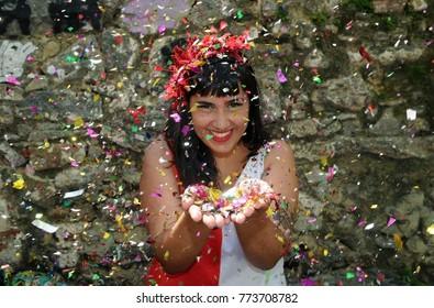 Rio de Janeiro, February 1, 2017. Girl throwing confetti during the Parade of the Bloco Empolga as Nine in the street carnival of the city of Rio de Janeiro, Brazil