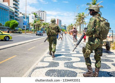 RIO DE JANEIRO - FEBRUARY 10, 2017: A pair of armed Brazilian Army soldiers patrol the boardwalk at Ipanema Beach with rifles to provide security during a local police strike over wages.