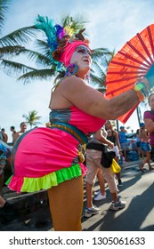 RIO DE JANEIRO - FEBRUARY 11, 2017: A Brazilian man in flamboyant pink costume struts her exaggeratedly voluptuous features at the Banda de Ipanema carnival street party.