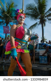 RIO DE JANEIRO - FEBRUARY 11, 2017: A Brazilian man in flamboyant pink costume struts her exaggeratedly voluptuous features at a carnival street party in Ipanema.