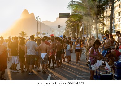 RIO DE JANEIRO - FEBRUARY 11, 2017: Young Brazilian friends celebrate Carnival at a sunset street party on the Ipanema beachfront.