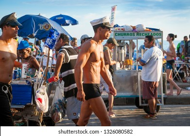 RIO DE JANEIRO - FEBRUARY 18, 2017: Crowds of Brazilians enjoy a Carnival street party on a summer afternoon in the Farme de Amoedo gay section of Ipanema Beach.