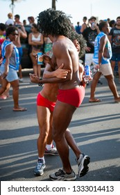 RIO DE JANEIRO - FEBRUARY 18, 2017: Young Brazilians enjoy a Carnival street party on a summer afternoon in Ipanema Beach.