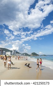RIO DE JANEIRO - FEBRUARY 27, 2016: Brazilians in iconic local swimwear enjoy an afternoon on Copacabana Beach.