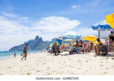 RIO DE JANEIRO - FEBRUARY 5, 2017: Beachgoers enjoy a hot summer day on Ipanema Beach.
