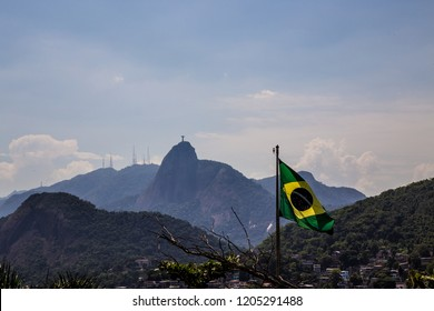Rio de Janeiro - Flag of Brazil with the Sugar Loaf in the background, in the neighborhood of Urca in the south zone of the city of Rio de Janeiro