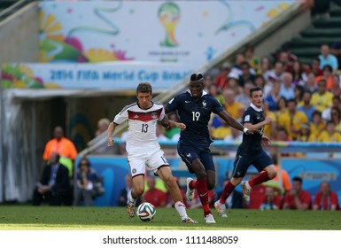 Rio de Janeiro, July 4, 2014 Football players Thomas Muller and Paul Pogba, during the match between France and Germany, for the 2014 world championships at the Maracanã stadium in Rio de Janeiro, Bra