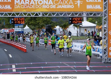 RIO DE JANEIRO - JULY 8: unidentified marathon runners cross the arrival line  at Maratona do Rio. Event Maratona do Rio, July 8, 2012 at Rio de Janeiro, Brazil
