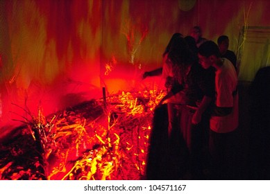 RIO DE JANEIRO - JUNE 04: in tent that simulates burning, as ecological disaster, the people attend special effects. Event Green Nation Fest,June 04, 2012 in Rio de Janeiro, Brazil.