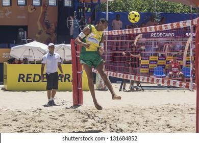 RIO DE JANEIRO - MARCH 09: The team's player of Brazil A, Marcellinho, heads the ball to opponent side. Event Mundial de Futevolei 4 X 4 2013,  March 09, 2013 in Rio de Janeiro, Brazil