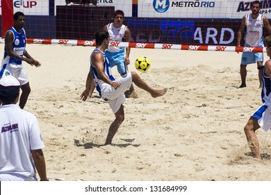RIO DE JANEIRO - MARCH 09: Unidentified player of Team of Italy kicks the ball.  Event Mundial de Futevolei 4 X 4 2013,  March 09, 2013 in Rio de Janeiro, Brazil