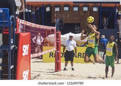 RIO DE JANEIRO - MARCH 09: The team's player of Brazil A, Renato Gaucho, heads the ball to opponent side. Event Mundial de Futevolei 4 X 4 2013,  March 09, 2013 in Rio de Janeiro, Brazil