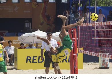 RIO DE JANEIRO - MARCH 09: Marcellinho, the team's player Brasil A executes  the play called Shark Attack. Event Mundial de Futevolei 4 X 4 2013,  March 09, 2013 in Rio de Janeiro, Brazil