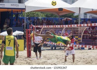 RIO DE JANEIRO - MARCH 10: Marcellinho, player of  the team Brasil A, makes an attack play.   Event Mundial de Futevolei 4 X 4 2013,  March 10, 2013 in Rio de Janeiro, Brazil