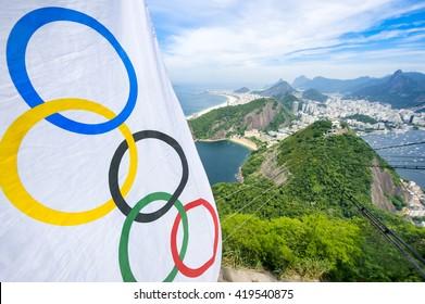 RIO DE JANEIRO - MARCH 10, 2016: Olympic flag hangs above a skyline view of the city from Pão de Açucar Sugarloaf Mountain.