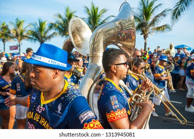 RIO DE JANEIRO - MARCH 15, 2017: Young Brazilian musicians playing in the brass band pass spectators in the iconic Banda de Ipanema Carnival street party parade.