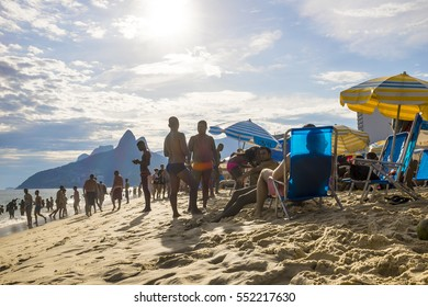 RIO DE JANEIRO - MARCH 15, 2015: Brazilians and tourists mingle in a typical summer afternoon scene on Ipanema Beach.