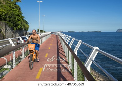 RIO DE JANEIRO - MARCH 19, 2016: A man rides a public share bike along the newly completed Tim Maia bike path connecting Ipanema and Copacabana with Barra, a venue for the 2016 Olympic Games.