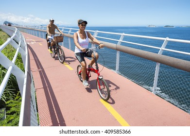 RIO DE JANEIRO - MARCH 19, 2016: Brazilians ride bicycles along the Tim Maia bike path, a legacy project of the 2016 Olympic Games connecting Ipanema and Copacabana with Barra.