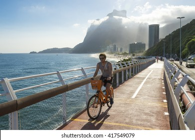 RIO DE JANEIRO - MARCH 19, 2016: A cyclist rides along the newly completed Ciclovia Tim Maia bike path connecting Ipanema and Copacabana with Barra, a legacy project from the 2016 Olympic Games.