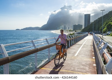 RIO DE JANEIRO - MARCH 19, 2016: A cyclist rides along the newly completed Tim Maia bike path connecting Ipanema and Copacabana with Barra, a legacy project from the 2016 Olympic Games.