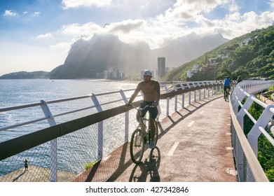 RIO DE JANEIRO - MARCH 19, 2016: A cyclist rides along the newly completed Ciclovia Tim Maia bike path, a legacy project from the 2016 Olympic Games connecting Ipanema and Copacabana with Barra.