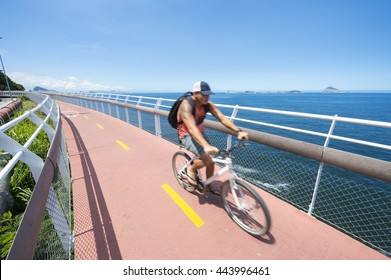 RIO DE JANEIRO - MARCH 19, 2016: Brazilians ride bicycles along the Ciclovia Tim Maia bike path, a legacy project of the 2016 Olympic Games connecting Ipanema and Copacabana with Barra.