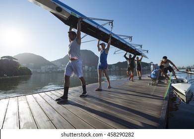 RIO DE JANEIRO - MARCH 22, 2016: After training, Brazilian rowers carry their boat back to the clubhouse at Lagoa Rodrigo de Freitas Lagoon, a venue for the Rio 2016 Olympic Games.