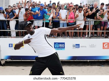 Rio de Janeiro, March 30, 2013. Olympic runner and athlete Usain Bolt, playing and dancing after participating in the 150m Rapid Strike Challenge at Copacabana Beach in Rio de Janeiro, Brazil