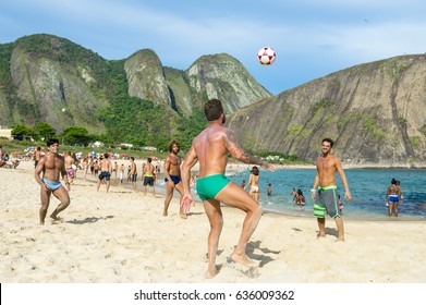 RIO DE JANEIRO - MARCH 4, 2017: Young Brazilians play a game of keepy-uppies (known locally as altinho) on the shore of Itacoatiara Beach.