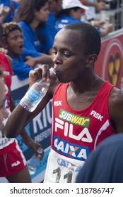 RIO DE JANEIRO - NOV 11: Edwin Kipsang Rotich drinks water after having crossed the arrival line at event Corrida Eu Atleta 10K Rio at November 11, 2012 Rio de Janeiro, Brazil