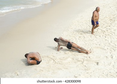 RIO DE JANEIRO - NOVEMBER 10, 2015: Training for the city's Guarda-Vidas (lifeguards) involves a rigorous test of stretching and physical endurance on Copacabana Beach.