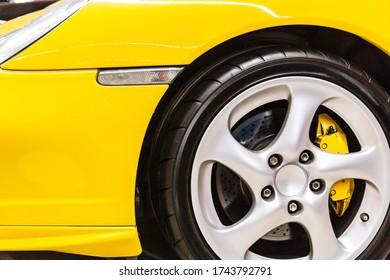 Rio de Janeiro, RJ - Brasil - 05-29-2020 - Yellow car fender with sports wheels - Shutterstock ID 1743792791