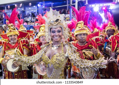 Rio de Janeiro, RJ / Brazil - 02 07 2016 - Pretty samba band godmother and percussionists of samba school 'Estacio de Sa', performing during 2016 carioca Carnival parade along the Sambadrome.