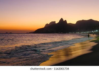 Rio de Janeiro, RJ / Brazil - 04 06 2016: Sunset seeing Two Brothers Hill (Morro Dois Irmaos) at Ipanema beach (Praia de Ipanema).