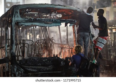 Rio de Janeiro, RJ, Brazil, April 28, 2018:  Burning Buses in Brazilian General Strike Protest against transportation fares and Government Reforms