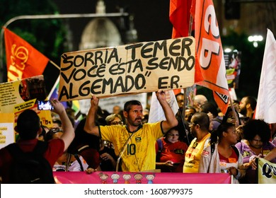 Rio de Janeiro / RJ / Brazil, March 22, 2019: Public act organized by syndicates and left-wing parties against Brazilian Social Security Reform. Banner for ex Brazilian president Temer.